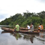 Canoeing down the Amazon River, local style