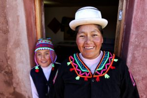 Mother and son in traditional coloured clothes, Lake Titicaca