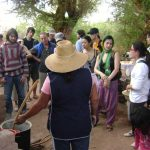 Nancy, a local Lickan Antay guide, showing the preparation of Arrope de Chañar to her visitors in the Atacama Desert