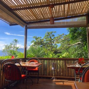 Have a fresh breakfast with a great view at Finca Rosa Blanca, a coffee plantation resort